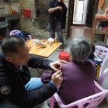 Michael Volunteering Missionary Relief in Village in China